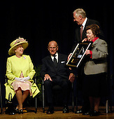 "Queen Elizabeth II is presented with a framed photograph of the Hubble Space Telescope by Rep. Steny Hoyer, D-Md., and Sen. Barbara Mikulski, D-Md., during a visit to the NASA Goddard Space Flight Center, Tuesday, May 8, 2007, in Greenbelt, Md. NASA and the British National Space Centre have collaborated on the Hubble project. The Royal couple's appearance was one of the last stops on a six-day visit to the United States. Photo Credit ""NASA/Paul E. Alers"""