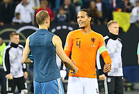 Virgil Van Dijk (Niederlande) mit Torwart Manuel Neuer (Deutschland Germany) - 06.09.2019: Deutschland vs. Niederlande, Volksparkstadion Hamburg, EM-Qualifikation DISCLAIMER: DFB regulations prohibit any use of photographs as image sequences and/or quasi-video.