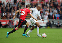 Pictured: Andre Ayew of Swansea (R) marked by Michael Carrick of Manchester United Sunday 30 August 2015<br /> Re: Premier League, Swansea v Manchester United at the Liberty Stadium, Swansea, UK