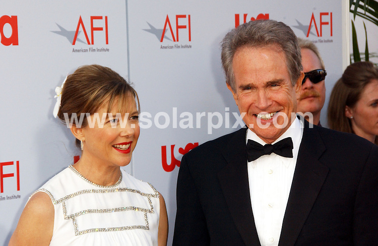 **ALL ROUND PICTURES FROM SOLARPIX.COM**.**SYNDICATION RIGHTS FOR UK, SPAIN, PORTUGAL, AUSTRALIA, S.AFRICA & DUBAI (U.A.E) ONLY**.The 36th AFI Life Achievement Award To Warren Beatty at the Kodak Theatre in Hollywood California in the USA. .This pic:Annette Bening,Warren Beatty.JOB REF:6628-PHZ/Albert L. Ortega   DATE: 12_06_08.**MUST CREDIT SOLARPIX.COM OR DOUBLE FEE WILL BE CHARGED* *UNDER NO CIRCUMSTANCES IS THIS IMAGE TO BE REPRODUCED FOR ANY ONLINE EDITION WITHOUT PRIOR PERMISSION*