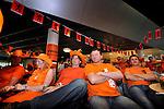 AMSTERDAM - In Amsterdam volgen heiers, kantoorpersoneel, productiemedewerkers en sales managers van Voorbij Funderingstechnieken in Amsterdam in de bedrijfskantine onder het genot van bier, limonade, snacks en kroketten gekleed in oranje bedrijfskleding, de voetbalwedstrijd Nederland - Denemarken tijdens het WK 2010 in Zuid-Afrika. Men was blij en juichte bij het eerste en tweede doelpunt, maar gelaten tijdens de rest van de wedstrijd. COPYRIGHT TON BORSBOOM