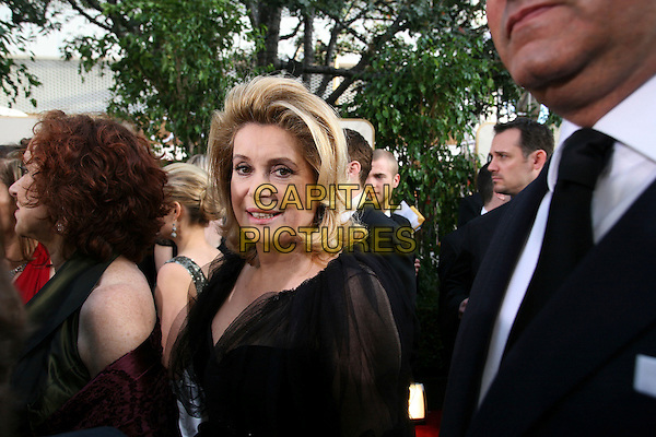 CATHERINE DENEUVE.Arrives for the 63rd Golden Globe Awards,.Beverly  Hills Hilton, California, USA,.January 16th 2006..half length globes red carpet .Ref: AW.www.capitalpictures.com.sales@capitalpictures.com.Supplied By Capital Pictures.