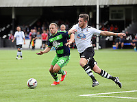 Pictured: Kyle Copp of Swansea (L) Saturday 11 July 2015<br />