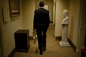 Washington, DC - October 30, 2009 -- United States President Barack Obama walks through the West Wing of the White House to deliver a birthday gift to Deputy Chief of Staff Jim Messina, October 30, 2009. .Mandatory Credit: Pete Souza - White House via CNP