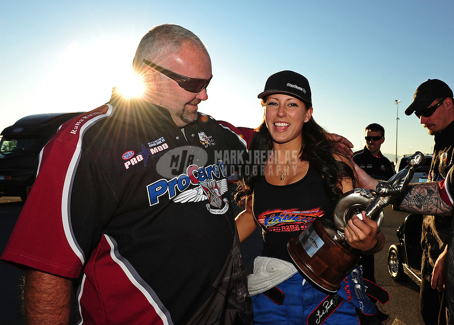 Oct. 30, 2011; Las Vegas, NV, USA: NHRA pro mod driver Leah Pruett (right) celebrates with crew chief Steve Petty after winning the Big O Tires Nationals at The Strip at Las Vegas Motor Speedway. Mandatory Credit: Mark J. Rebilas-