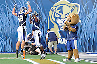 9 October 2010:  FIU wide receiver T.Y. Hilton (4) celebrates his first-quarter touchdown with wide receiver Greg Ellingson (82) as the FIU Golden Panthers defeated the Western Kentucky Hilltoppers, 28-21, at FIU Stadium in Miami, Florida.