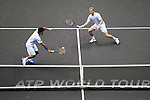 BANGKOK, THAILAND - OCTOBER 01:  Dimitry Tursunov (R) of Russia and Kittipong Wachiramanowong of Thailand in action during their doubles match against Jonathan Erlich of Israel and Jurgen Melzer of Austria clean the court during the Day 7 of the PTT Thailand Open at Impact Arena on September 30, 2010 in Bangkok, Thailand. Photo by Victor Fraile / The Power of Sport Images