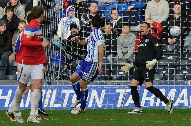 Manuel Pascali heads past Allan McGregor to score for Kilmnarnock