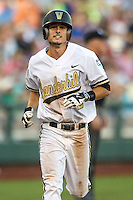 Vanderbilt Commodores outfielder Rhett Wiseman (8) crosses the plate after smashing a home run against the TCU Horned Frogs in Game 12 of the NCAA College World Series on June 19, 2015 at TD Ameritrade Park in Omaha, Nebraska. The Commodores defeated TCU 7-1. (Andrew Woolley/Four Seam Images)