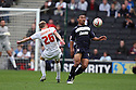 Darius Charles of Stevenage clears from Luke Chadwick of Milton Keynes. MK Dons v Stevenage - npower League 1 - Stadium MK,  Milton Keynes - 20th October, 2012. © Kevin Coleman 2012
