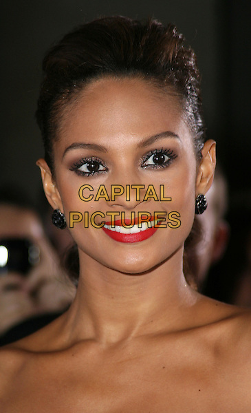 ALESHA DIXON.At the Variety Club Showbiz Awards held at the Grosvenor House Hotel, Park Lane, London, England, UK, .November 15th 2009..portrait headshot strapless red lipstick make-up flower black earrings hair up smiling .CAP/JIL.©Jill Mayhew/Capital Pictures