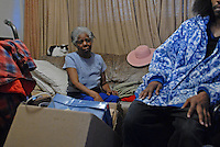 """Dolores Wilson, 78, in her eighth floor apartment with Timothy """"Timo"""" Hartfield, 29, discussing the morning's police raid in a Cabrini Green high rise at 1230 N. Burling in Chicago, Illinois on December 18, 2007.  Wilson is a matriarch-like figure in her building and is known affectionately as """"Mrs. Wilson"""" to many and she was the last tenant to move out of Cabrini Green."""