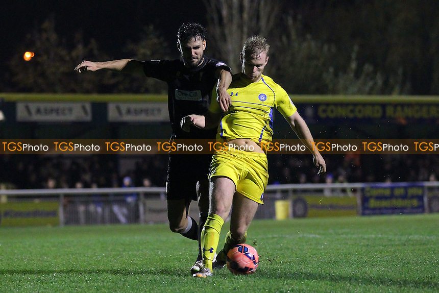 Stephen Cawley of Concord Rangers and Ryan Tafazolli of Mansfield Town - Concord Rangers vs Mansfield Town - FA Challenge Cup 1st Round Replay Football at the Aspect Arena, Thames Road, Canvey Island, Essex - 25/11/14 - MANDATORY CREDIT: Gavin Ellis/TGSPHOTO - Self billing applies where appropriate - contact@tgsphoto.co.uk - NO UNPAID USE