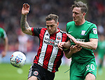 Billy Sharp of Sheffield Utd and Ben Davies of Preston North End during the championship match at the Bramall Lane Stadium, Sheffield. Picture date 28th April 2018. Picture credit should read: Simon Bellis/Sportimage