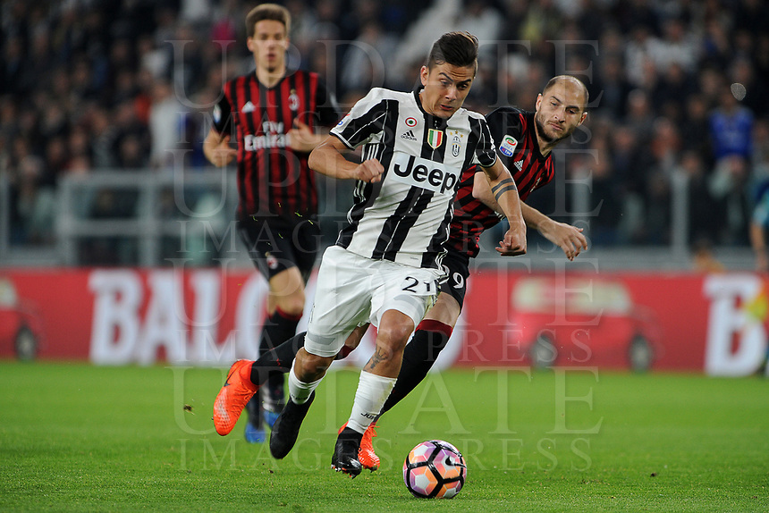 Calcio, Serie A: Juventus vs Milan. Torino, Juventus Stadium, 10 marzo 2017.<br /> Juventus' Paulo Dybala, left, is challenged by AC Milan's Gabriel Paletta during the Italian Serie A football match between Juventus and AC Milan at Turin's Juventus Stadium, <br /> UPDATE IMAGES PRESS/Manuela Viganti