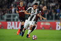 Calcio, Serie A: Juventus vs Milan. Torino, Juventus Stadium, 10 marzo 2017.<br /> Juventus&rsquo; Paulo Dybala, left, is challenged by AC Milan's Gabriel Paletta during the Italian Serie A football match between Juventus and AC Milan at Turin's Juventus Stadium, <br /> UPDATE IMAGES PRESS/Manuela Viganti