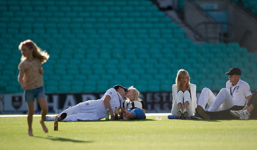 England's Joe Root (left) and Stuart Broad relaxing on the pitch at the end of the day<br /> <br /> Photographer Ashley Western/CameraSport<br /> <br /> International Cricket - Investec Ashes Test Series 2015 - Fifth Test - England v Australia - Day 4 - Sunday 23rd August 2015 - Kennington Oval - London<br /> <br /> &copy; CameraSport - 43 Linden Ave. Countesthorpe. Leicester. England. LE8 5PG - Tel: +44 (0) 116 277 4147 - admin@camerasport.com - www.camerasport.com
