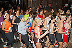 Runners in the Womens section of the Empire State Building stair run-up crowd to get through a doorway to begin their 86 storey stair climb.