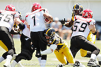 July 10, 2010; Hamilton, ON, CAN; Hamilton Tiger-Cats defensive end Garrett McIntyre (71) sacks Calgary Stampeders quarterback Henry Burris (1). CFL football: Calgary Stampeders vs. Hamilton Tiger-Cats at Ivor Wynne Stadium. The Tiger-Cats lost against the Stampeders 23-22. Mandatory Credit: Ron Scheffler. Copyright (c) 2010 Ron Scheffler.