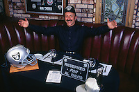 SAN LEANDRO, CA - Ricky Ricardo, owner of Ricky's Sports Bar in San Leandro, California, has a table set aside for Oakland Raiders owner Al Davis when the team moved back to the Bay Area in 1995. (Photo by Brad Mangin)