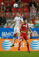 26 June 2010:  Los Angeles Galaxy forward Alan Gordon #21 and  Toronto FC defender Dan Gargan #8 in action during a game between the Los Angeles Galaxy and the Toronto FC at BMO Field in Toronto..Final score was 0-0...