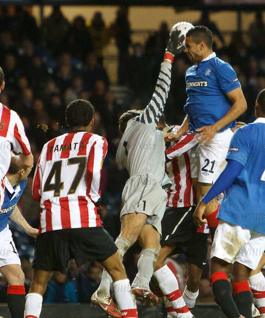 Kyle Bartley collides with keeper Andreas Isaksson