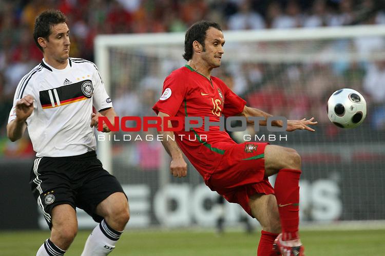 UEFA Euro 2008 Quarter-Finals Match 25 Basel - St. Jakob-Park. Portugal ( POR ) - Deutschland ( GER ). <br /> Miroslav Klose ( Germany / Angreifer / Forward / Bayern Muenchen #11 ) (l) im Kampf um den Ball mit Ricardo Carvalho ( Portugal / Verteidiger / Defender / FC Chelsea #16 ) (r).<br /> Foto &copy; nph (  nordphoto  )