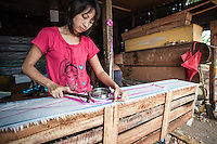 People of Burma believe in secrecy of moment of death. And the way person is sent in last way is very important.<br /> Proper funeral expenses in big city like Yangon can cost minimum 1000US dollars - amount impossible for poor families.<br /> On the photo: woman decorates coffin