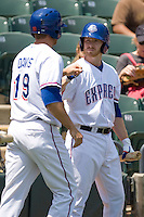 Round Rock Express RF Doug Deeds (21) greets Chris Davis (19) after he scores against the Iowa Cubs on April 10th, 2011 at Dell Diamond in Round Rock, Texas.  (Photo by Andrew Woolley / Four Seam Images)