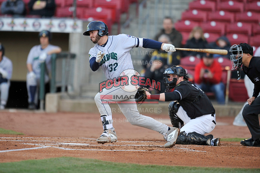 Cedar Rapids Kernels catcher Chris Williams (32) swings at a pitch against the Quad Cities River Bandits at Veterans Memorial Stadium on April 15, 2019 in Cedar Rapids, Iowa.  The River Bandits won 7-2.  (Dennis Hubbard/Four Seam Images)