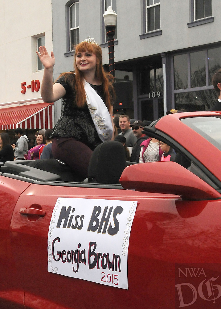 NWA Democrat-Gazette/FLIP PUTTHOFF<br /> Georgia Brown, Miss Bentonville High School, rides Saturday Dec. 12, 2015 in the Bentonville Christmas Parade.