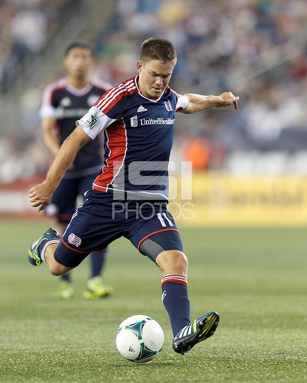 New England Revolution midfielder Kelyn Rowe (11) takes a shot. In a Major League Soccer (MLS) match, the New England Revolution (blue) defeated Chicago Fire (red), 2-0, at Gillette Stadium on August 17, 2013.