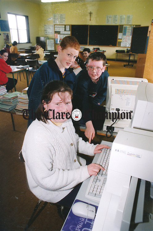 Elaine Farrell, Conor Cooney and Michael Jones working on the school computers - May 21, 1999. Photograph by Eamon Ward