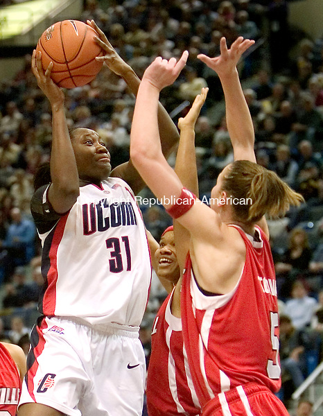 HARTFORD, CT. 05 March 2007-030507SV04--#31 Tina Charless of UConn goes up for a shot as #5 Yuliya Tokova of Louisville defends during Big East semifinal tournament action at the Hartford Civic Center in Hartford Monday.<br /> Steven Valenti Republican-American