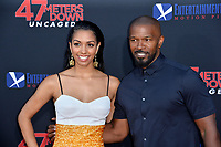 """LOS ANGELES, USA. August 14, 2019: Corinne Foxx & Jamie Foxx at the premiere of """"47 Meters Down: Uncaged"""" at the Regency Village Theatre.<br /> Picture: Paul Smith/Featureflash"""