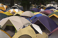"A ""tent city"" is set up at Durango High School to temporarily ""house"" the thousands of interagency wildland firefighters who arrived in Durango, Colorado to fight the Missionary Ridge Fire in June, 2002."