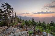 July 2014 - Sunrise from Mount Tecumseh in Waterville Valley, New Hampshire during the month of July. Vandalism (illegal tree cutting) has improved the view from the summit. Forest Service verified the cutting is illegal and unauthorized.