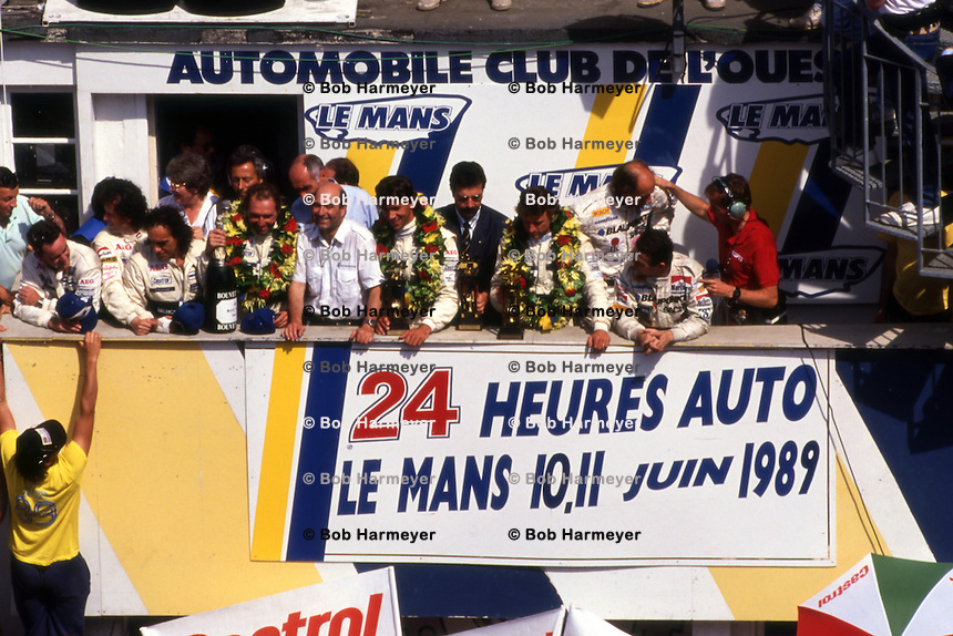 LE MANS, FRANCE - JUNE 11: The winning teams celebrate on the podium following the 24 Hours of Le Mans at the Circuit de la Sarthe in Le Mans, France, on June 11, 1989.