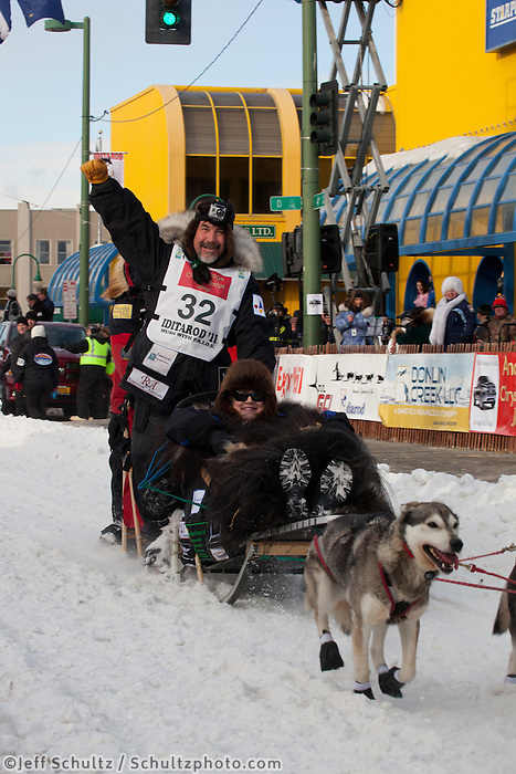 Musher Scott Janssen and Iditarider Deborah Menendez.leave the 2011 Iditarod ceremonial start line in downtown Anchorage, Alaska