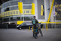 16th May 2020, Signal Iduna Park, Dortmund, Germany; Bundesliga football, Borussia Dortmund versus FC Schalke;   Outdoor shot before the first matchday of the Ghost Games because of the coronavirus In the picture Fan and cyclist watching the game on his smartphone at the Signal Iduna Park Dortmund Park