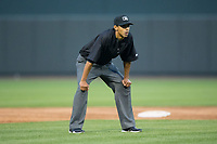 Umpire Ronnie Whiting handles the calls on the bases during the Carolina League game between the Myrtle Beach Pelicans and the Winston-Salem Dash at BB&T Ballpark on May 11, 2017 in Winston-Salem, North Carolina.  The Pelicans defeated the Dash 9-7.  (Brian Westerholt/Four Seam Images)