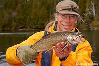 Sport fishing for splake Man holding nice splake trout