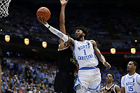 CHAPEL HILL, NC - MARCH 03: Leaky Black #1 of the University of North Carolina shoots a layup under Olivier Sarr #30 of Wake Forest University during a game between Wake Forest and North Carolina at Dean E. Smith Center on March 03, 2020 in Chapel Hill, North Carolina.