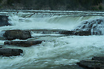 Kootenai falls flowing swiftly during the snow melt in Montana