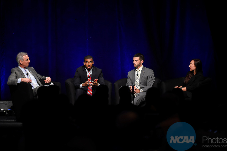 "15 JAN 2015:  The NCAA Keynote Luncheon takes place during the 2015 NCAA Convention held at the Gaylord National Resort and Convention Center in National Harbor, MD.  Jamie Schwaberow/NCAA Photos  (Pictured:  Oliver Luck, Roberto ""Bubba"" Baroniel, Chelsea Shoemaker, Kendall Spencer)"