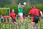 Colm Kearins Milltown/Castlemaine full forward gets the ball ahead of Paddy O'Connell Clondegad in the quarter final of the Munster Intermediate Club championship at Milltown on Sunday