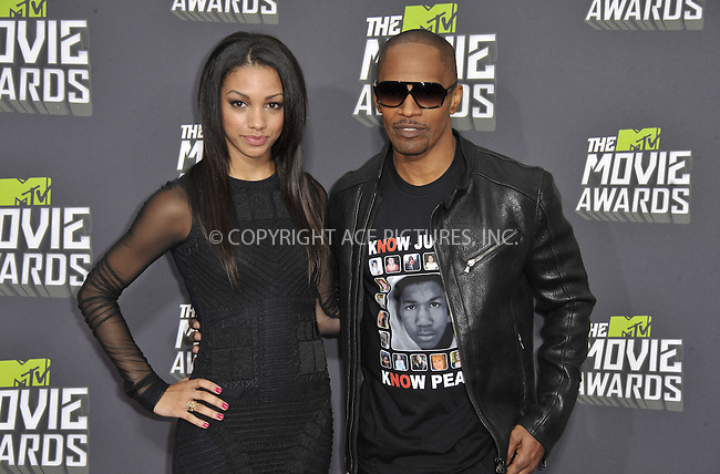 WWW.ACEPIXS.COM....April 14 2013, LA......Actor Jamie Foxx (R) and daughter Corinne Bishop arriving at the 2013 MTV Movie Awards at Sony Pictures Studios on April 14, 2013 in Culver City, California. ....By Line: Peter West/ACE Pictures......ACE Pictures, Inc...tel: 646 769 0430..Email: info@acepixs.com..www.acepixs.com