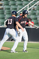 Hunter Jones (1) of the Kannapolis Intimidators celebrates with teammate Carl Thomore (13) after hitting a 2-run home run against the Hagerstown Suns at CMC-Northeast Stadium on May 31, 2014 in Kannapolis, North Carolina.  The Intimidators defeated the Suns 3-2 in game one of a double-header.  (Brian Westerholt/Four Seam Images)