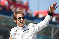 March 15, 2015: Jenson Button (GBR) #22 from the McLaren Honda team waves to fans during the drivers' parade at the 2015 Australian Formula One Grand Prix at Albert Park, Melbourne, Australia. Photo Sydney Low