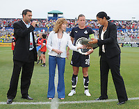 Steffi Jones (former Freedom player) receiving the induction of the Hall of Freedom from the Maureen Hendricks Chairwoman.  The LA Sol defeated the Washington Freedom 1-0 at the Maryland Soccerplex, Sunday July 5, 2009.